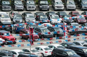 Halifax, Canada - June 20, 2014: Looking down onto a car dealership featuring a wide variety of vehicles ranging from compact sedans to full size pickup trucks.